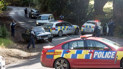 Two dead, house ablaze in NZ stand-off