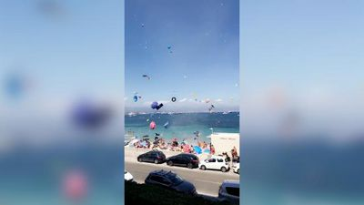 Dust devil causes chaos for beachgoers