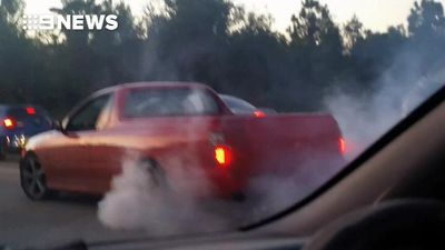 'Idiot' hoon does burnouts on busy Gold Coast highway