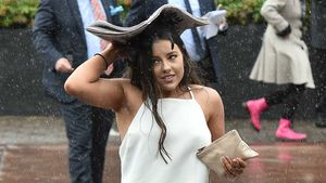 Racegoers battle wet and wild Cox Plate