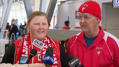 Wild winds leave Swans fans stranded at Sydney Airport