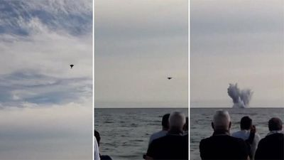 Pilot dies as fighter jet crashes into sea at air show