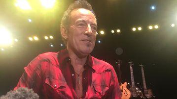 Bruce Springsteen speaking to reporters in Perth. (AAP)