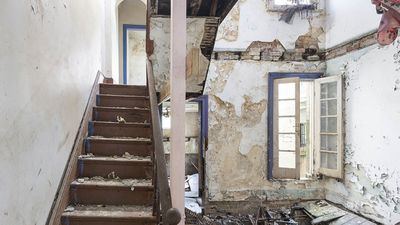 Hoarder home with rotted floors and no ceiling asks for $1.5m