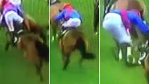 Jockey jumps off horse