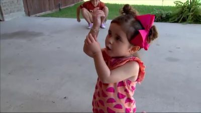 Scary moment toddler gets caught in garage door