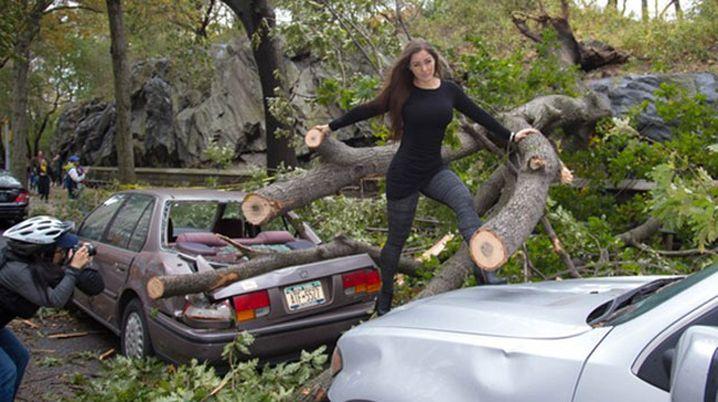 Brazilian model/actress Nana Gouvêa poses amidst debris after superstorm Sandy.