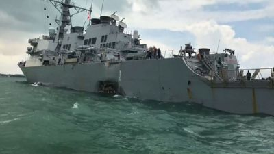 Massive hole in side of US Navy ship missing 10 sailors