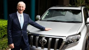 Legendary commentator Bill Lawry receives a car for his 80th birthday
