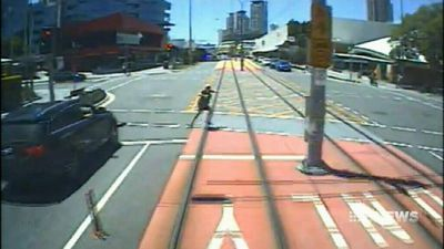 CCTV shows people putting lives on the line near trams