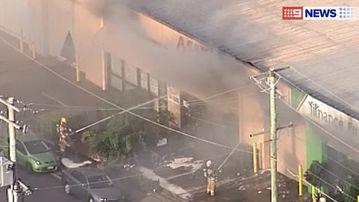 Firefighters battle the blaze. (9NEWS)