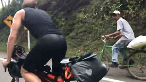 Farmer effortlessly outrides pro-cyclist uphill