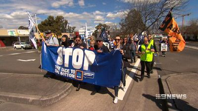 Hundreds of truckies converge at Aldi to protest driving conditions