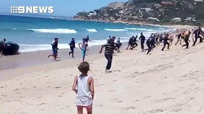 Boatload of migrants stun Spanish sunbathers