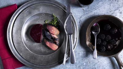 Mike Eggert's rare roasted goat baked in an ashed bread crust, with roast beetroot, and blackcurrant dressing