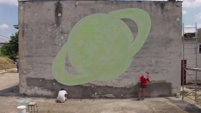 Secret, glowing images are hidden in these beautiful street murals