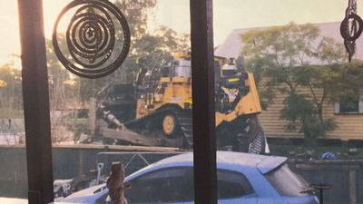 Victim relives moment man bulldozed her house