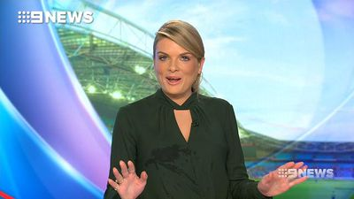 Erin Molan falls off her chair during live news bulletin