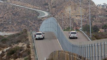 Border Patrol agents patrol the United States-Mexico Border wall during Opening the Door Of Hope/Abriendo La Puerta De La Esparana at Friendship Park in San Ysidro, California in November, 2016.