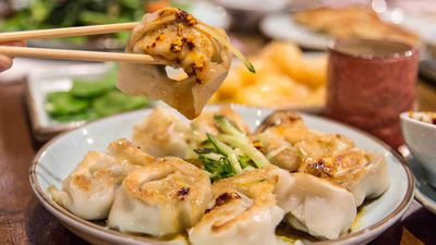 Shepherd's purse and pork wontons with chilli oil, peanut and sesame sauce
