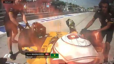 F1 practice halted due to fire in pit lane