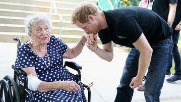 Prince Harry kisses 95-year-old Ruth Ufflerman. (Chris Radburn/PA Wire)
