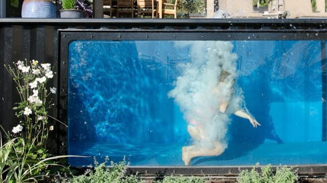 This shipping container swimming pool can be used at any time of year