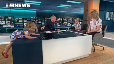 Mischevious young girl hijacks mum's news interview