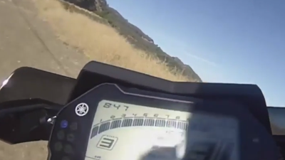 This motorcyclist is just a second from plunging off a cliff