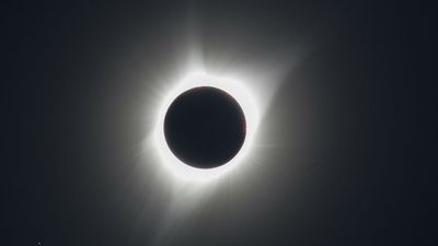 Cheers as sky-gazers treated to stunning total eclipse