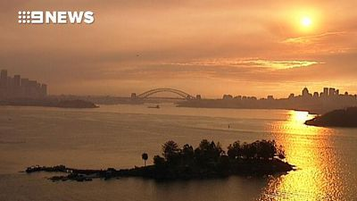 Smoke creates stunning sunset vista of Sydney
