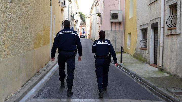 Gendarmes patrol in a street in Marseillan. (AFP)