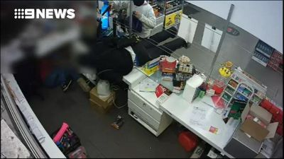 The moment armed thieves storm a Melbourne service station
