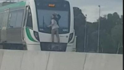 Man filmed clinging to back of speeding train in Perth