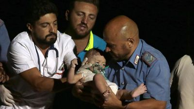 Three brothers pulled from Italy quake rubble in miracle rescue