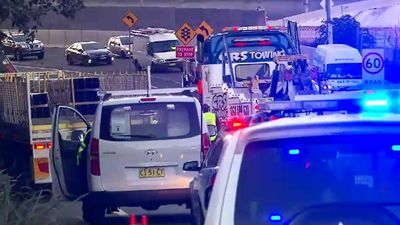Driver fighting for life after being run over by own truck