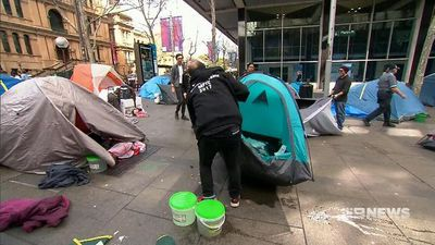 Sydney tent city moves but vows fight on