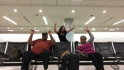 Stranded woman dances through empty airport