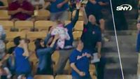 Baseball fan chooses ball over baby