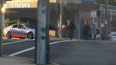 Australia's kindest cop? Officer stops traffic to help elderly woman