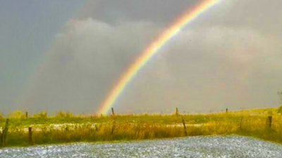 Freak hail storm delivers rainbow and fields of white