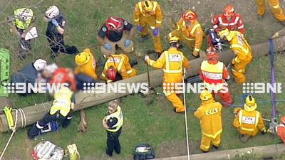 Man freed after legs crushed by power pole