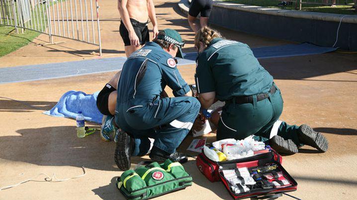Paramedics treat an athlete at the Endure Batavia Triathlon in Western Australia. (Everything Geraldton)
