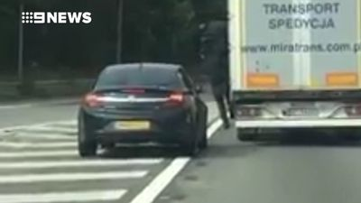 Stowaways filmed leaping out of truck on busy highway