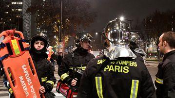Firemen near the robbery scene. (AFP)