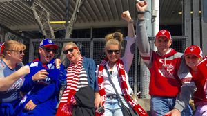 A sea of red, white and blue at AFL grand final parade