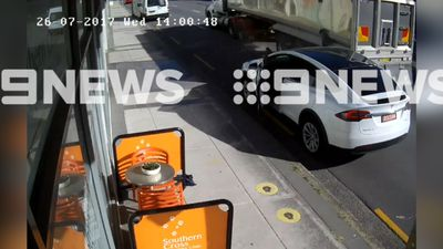 Moment $200k supercar's wing is smashed by truck