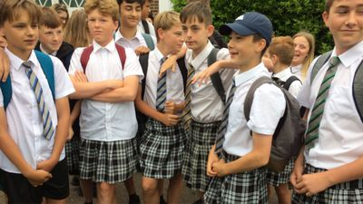 Teenage boys wear skirts to school to protest hot weather shorts ban