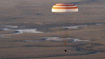 A capsule carrying NASA's Jeff Williams, Russian cosmonauts Alexey Ovchinin and Oleg Skripochka descends in Kazakhstan. (AAP)