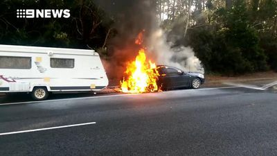 Elderly couple alerted moments before their car burst into flames